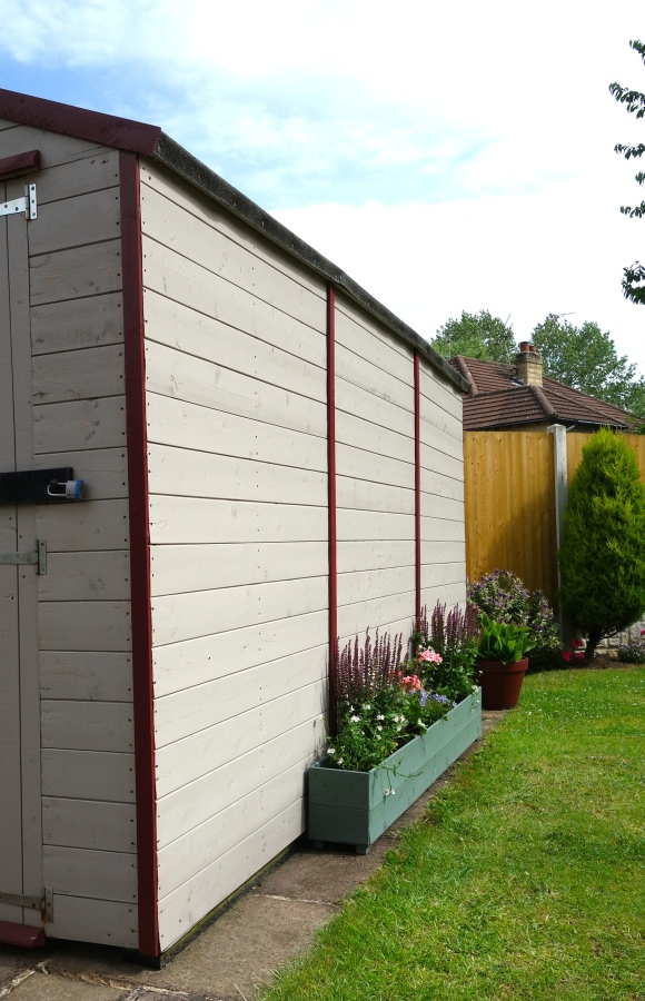 muted clay timber garage and trough