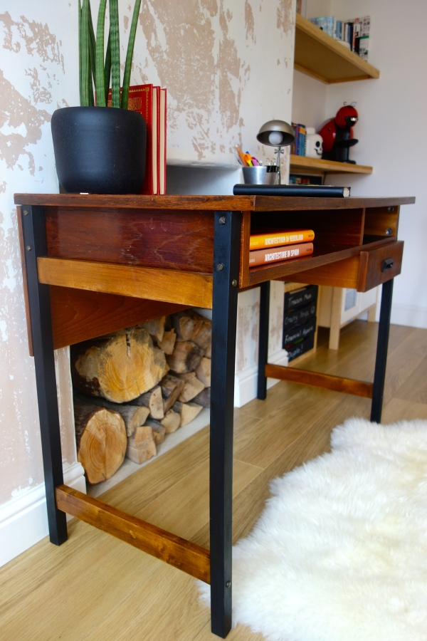 Industrial style frame with black legs and original hardware.