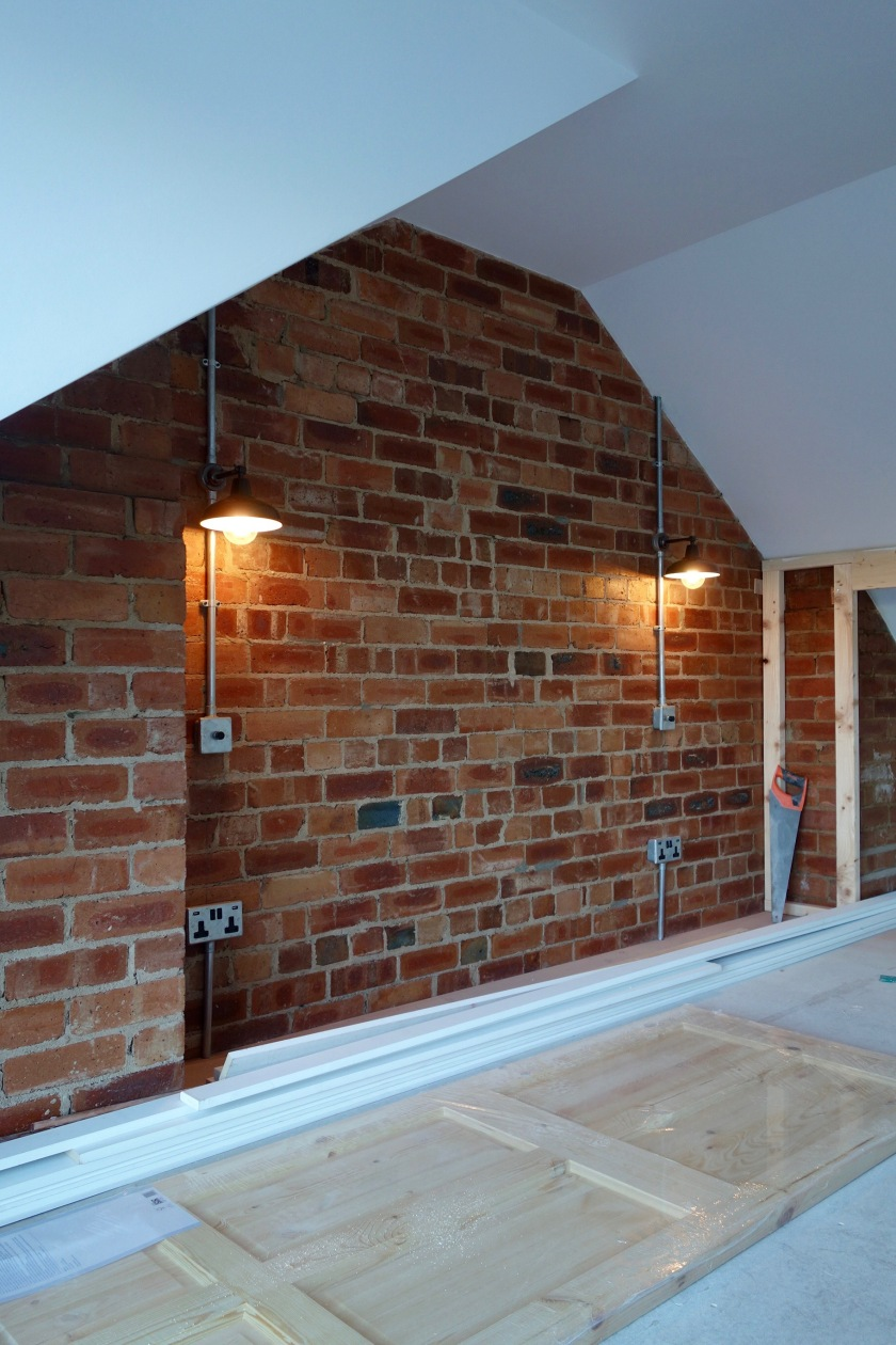 exposed-brick-wall-and-conduit