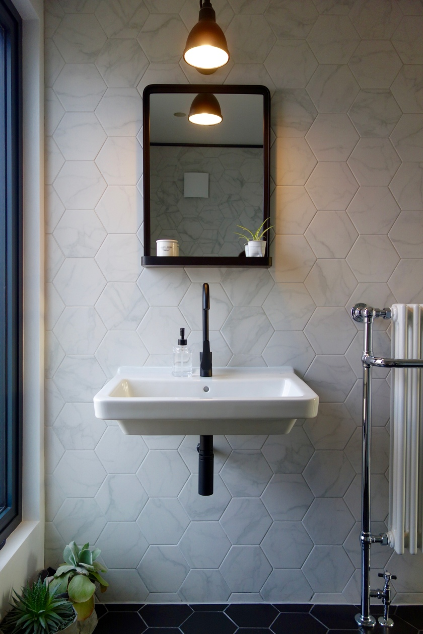 The Loft shower room black tap and bathroom mirror with shelf